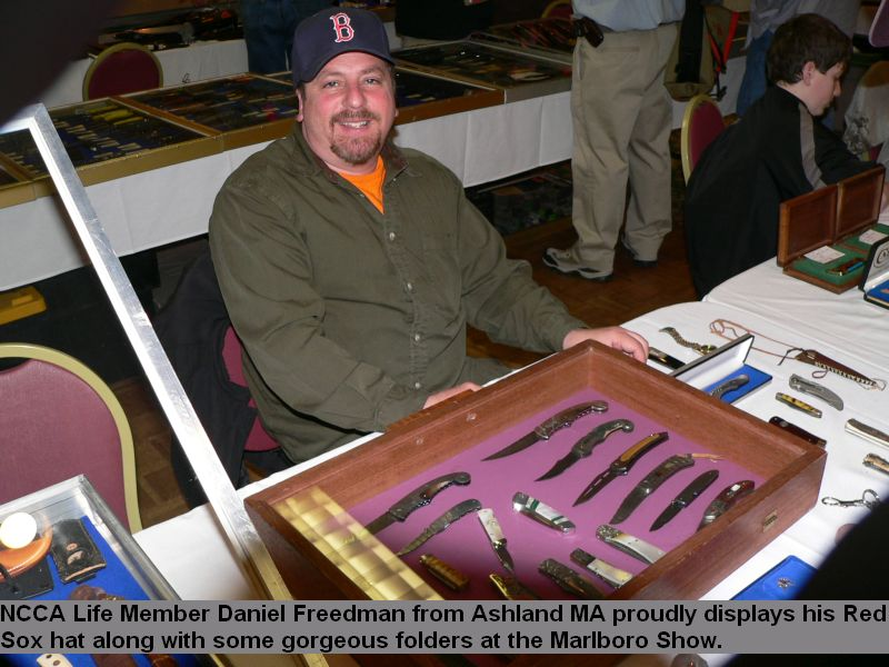 NCCA Life Member Daniel Freedman from Ashland MA proudly displays his Red Sox hat along withsome gorgeous folder at the Marlboro Show.