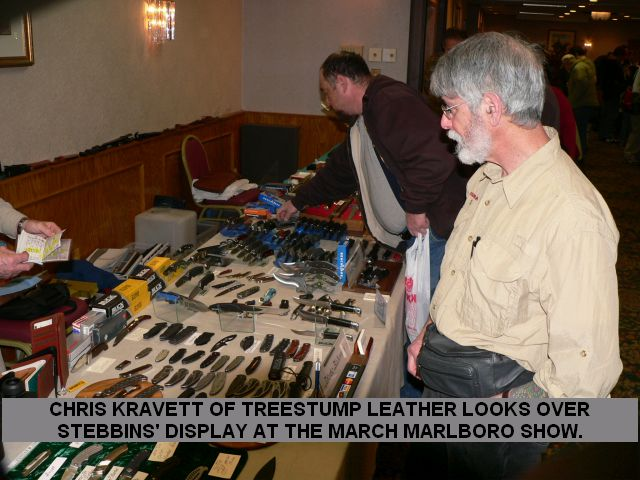 Chris Kravett of Treestump Leather looks over Stebbins' display at the March Marlboro Show.