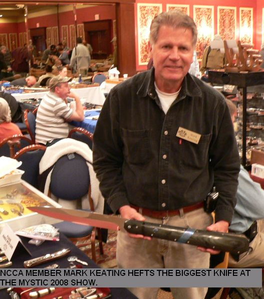 NCCA member Mark Keating hefts the biggest knife at the mystic 2008 show.
