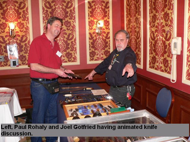 Left, Paul Rohaly and Juel Gotfried having animated knife discussion.