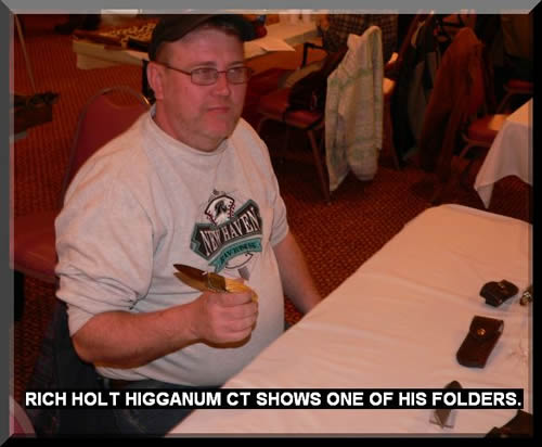 RICH HOLT HIGGANUM CT SHOWS ONE OF HIS FOLDERS.