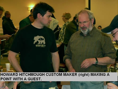 HOWARD HITCHMOUGH CUSTOM MAKER (right) MAKING A POINT WITH A GUEST.