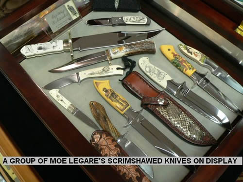 A GROUP OF MOE LEGARE'S SCRIMSHAWED KNIVES ON DISPLAY