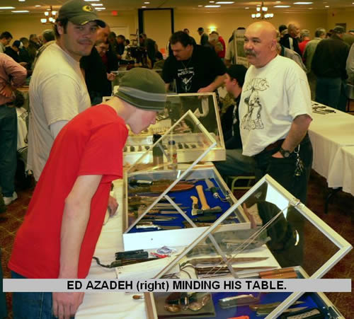 ED AZEDEH )right) MINDING HIS TABLE.